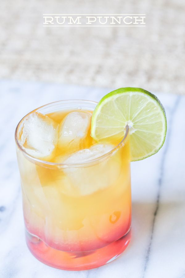Rum Punch  3 ounces fresh pineapple juice 2 ounces fresh orange juice 1 ounce gold (or dark) rum + 1/2 ounce to pour on top 1 ounce coconut rum grenadine and lime to garnish