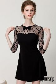 The dress featuring dotted pattern. Semi-sheer mesh at sleeve and back. Round neckline with bowknot. 3/4 sleeve. Back zipper. A-line.