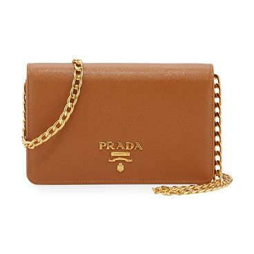 "Saffiano Lux Crossbody Bag by Prada. Prada saffiano leather crossbody bag. Golden hardware. Removable chain-link shoulder strap, 22"" drop. Flap top with l..."