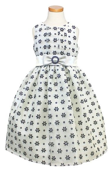 Free shipping and returns on Sorbet Daisy Flocked Taffeta Dress (Toddler Girls & Little Girls) at Nordstrom.com. Delicate daisies flock the light tulle overlay of a playful taffeta dress fitted with a sleeveless fitted bodice. A twirl-worthy petticoat adds fun flounce to the skirt, while a white sash adds the final girly touch.
