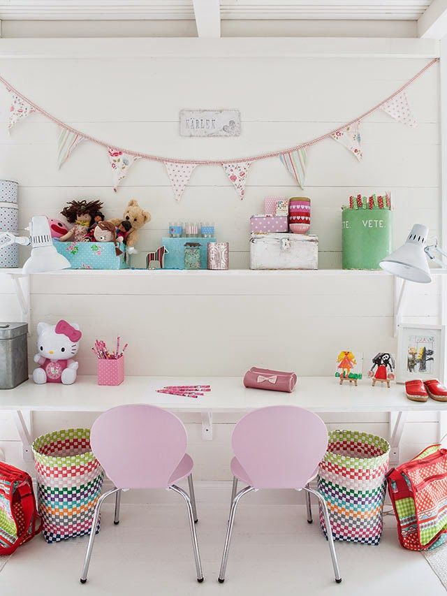 children's playroom area | modern wood desk, desk chairs + open shelves | vintage accessories | metal boxes | suitcases | colorful modern detail | bunting