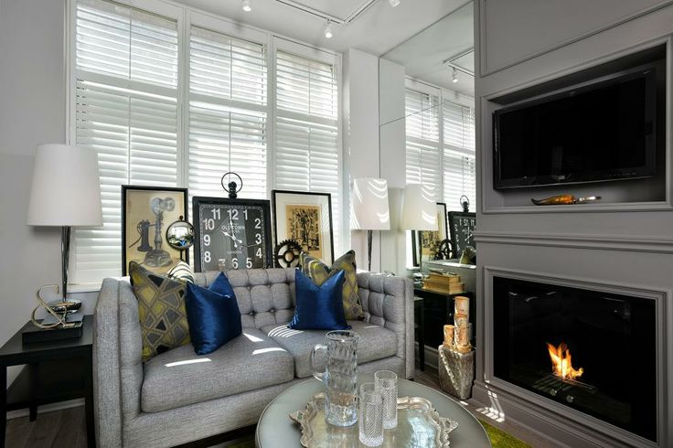 Living room space designed by Glen & Jamie from Peloso Alexander Interiors. #GlenandJamie #Design #sofa #fireplace #lamp #table #art
