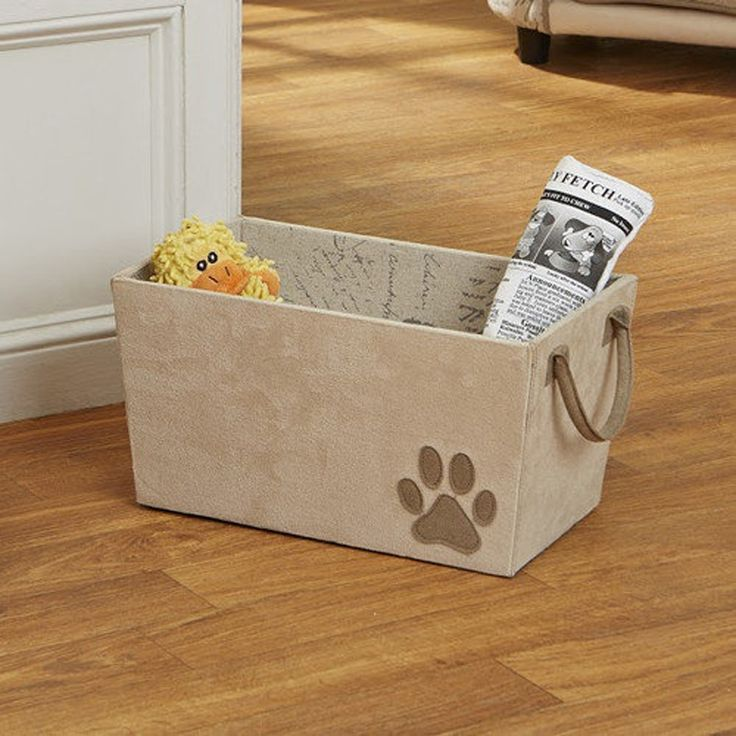 Store pet toys out of site with the fashionable Dog Toy Basket - non-slip bottom and lined inside protect contents - features cute paw print decal