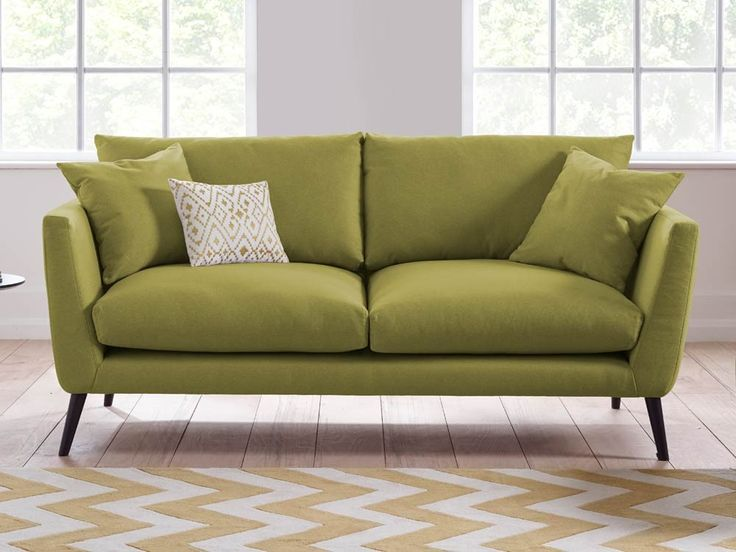 Marcy Sofa - Marcy is a unique sofa with its wedge shape and hand carved wooden legs - by www.livingitup.co.uk
