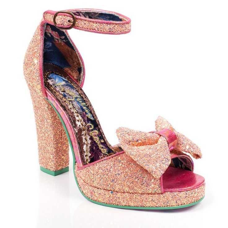 Unleash your inner Betty Boop and boop oop a doop all over these beautiful glittering platform heels. With a pretty baby pink colour encrusted with multi coloured glitter these heels are girly glam all over.  Platform heel sandal  Encrusted glitter upper  Buckle fastening ankle strap  Matching glitter bow
