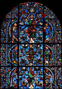 Among the famous stained glass windows of Chartres Cathedral in Northern France is the Jesse Tree window, of 1140-50, the far right of three windows above the Royal Portal and beneath the western rose window. It derives from the oldest known (and almost certainly the original) complex form of the Jesse Tree, with the tree rising from a sleeping Jesse, a window placed in the Saint-Denis Basilica by Abbot Suger in about 1140, which is now heavily restored.