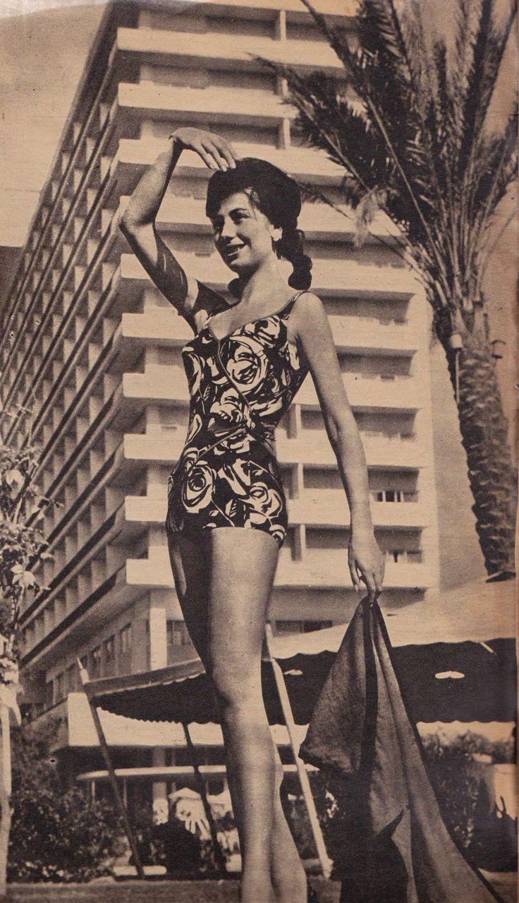 A Swimmer Enjoys The Nile Hilton's Swimming Pool