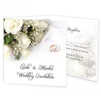 The wedding bands and wedding flowers  wedding invitation has an elegant design of white roses and wedding bands. Available on white or pearlescent card. This invite design has a classic romantic theme to it. This invite has a perforated rsvp panel along with an extra panel for important information such as directions and accommodation.