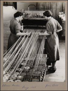 Scottish Textile Heritage Online is a groundbreaking pilot project aiming to provide a one-stop shop for researchers wanting information about the richness and diversity of these collections.  Women employees Chrissie Maxton and Jessie Bell on the factory floor of James Templeton & Co Ltd, Glasgow, May 1955.  (GUAS Ref: UGD 265/1/1...