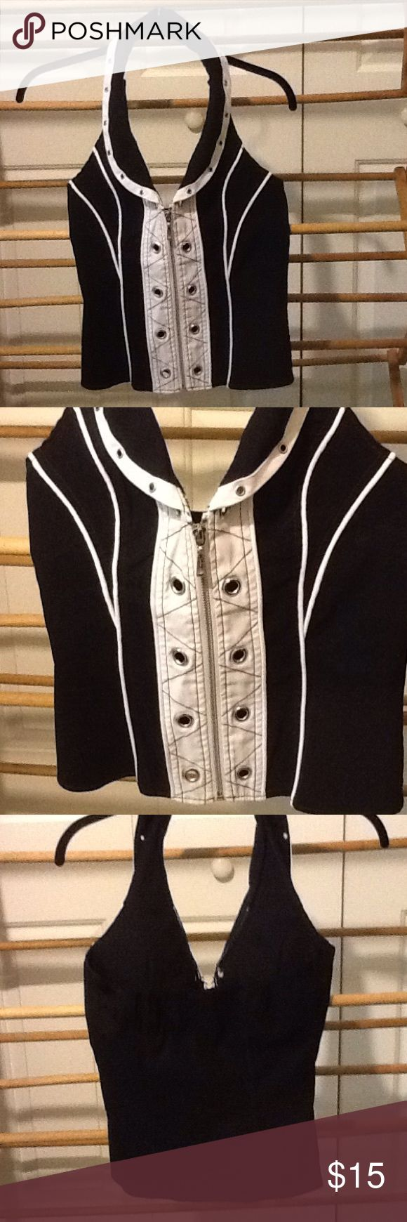 "Sexy. Black and White Vest Women's size small cotton, nylon, and spandex black and white vest. Zips up. Cool design. Will be fitted tight. 26"" bust, 26"" waist. 23"" long. In good condition. ole ole Jackets & Coats Vests"