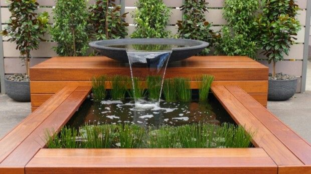 this is a stunning water feature with fresh wood and bowl | adamchristopherdesign.co.uk