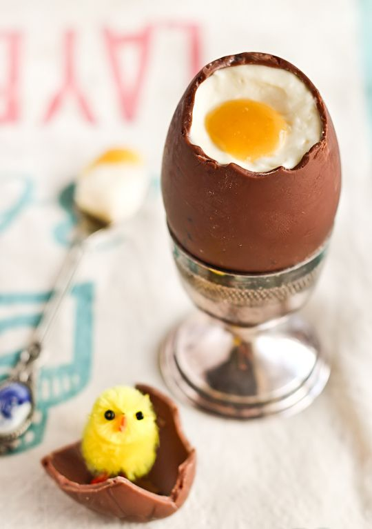 How fun is this? Cheese cake filled chocolate Easter Eggs....buy hollow chocolate eggs and fill with cheese cake and a yellow fruit center she used passion fruit but you could use lemon curd also. I AM DOING THIS!! @Bailee Kaul Fogle