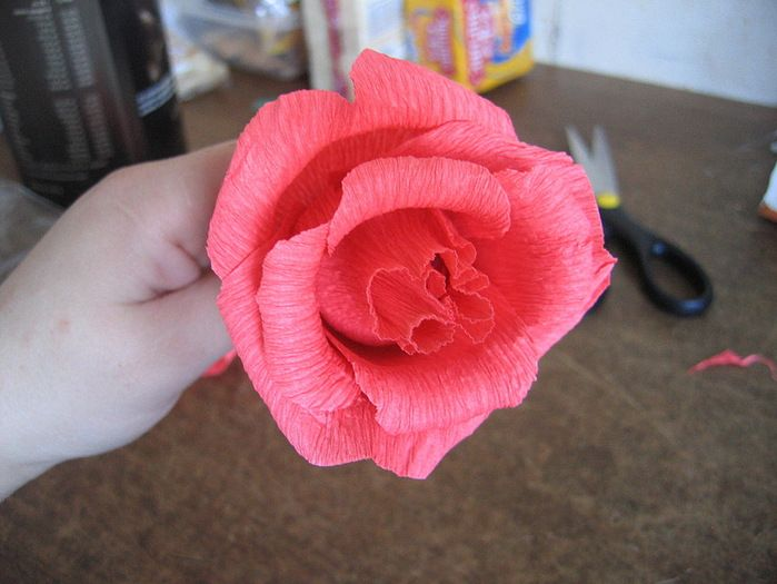 Make this out of crepe paper (the rolls for streamer decorations at parties)! There's a candy wrapped up in it too. How pretty!