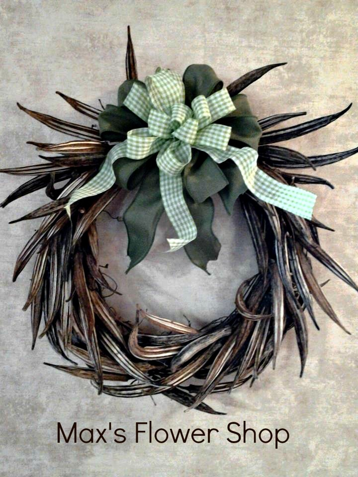 Dried okra pod wreath with green burlap and green & white gingham bow.