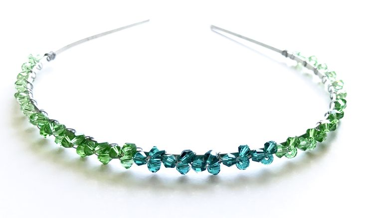 Green crystal handmade headband for prom, wedding or any other occasion.  In creating this headband we used: - High quality, silver tone, metal headband,  - 4mm green bicone crystals - 4mm dark green bicone crystals - Silver tone wire