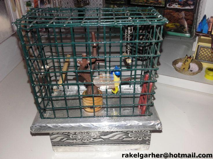 escenas en miniatura RakelGH: Tienda de mascotas detalle jaula loro