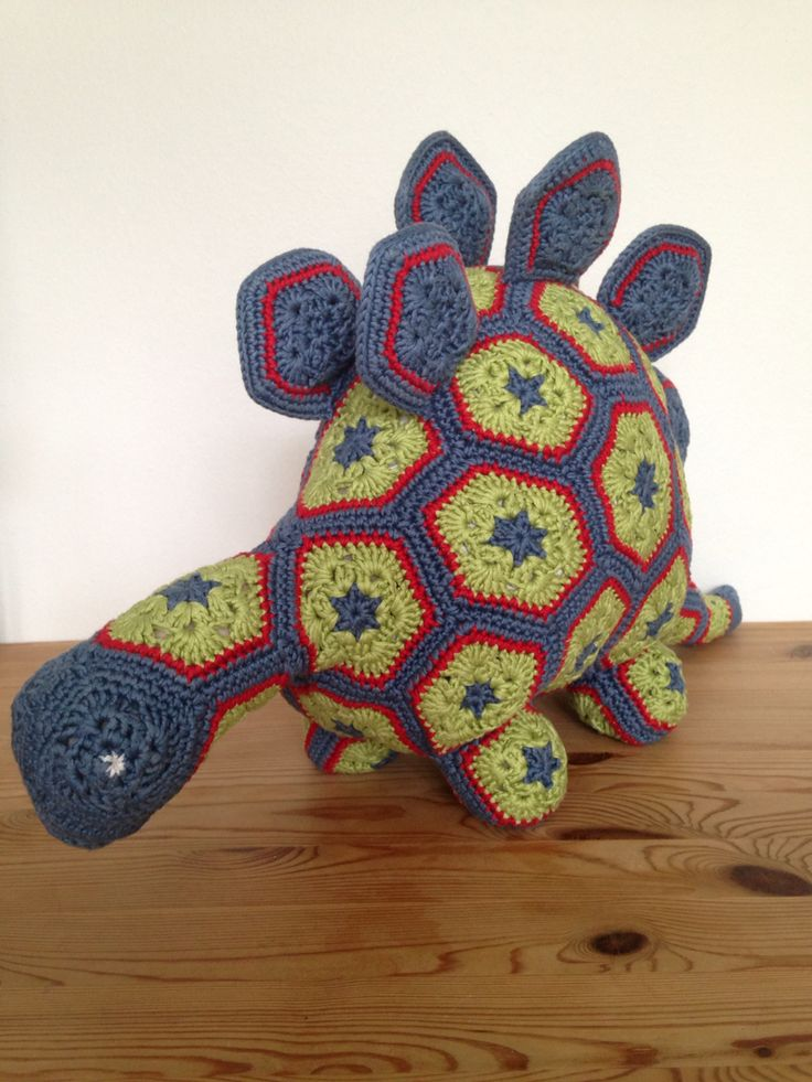 Doris the dinosaur ❤️ Crochet and with crackle plastic in the spikes so they crack when touched. 2014 - Andrea