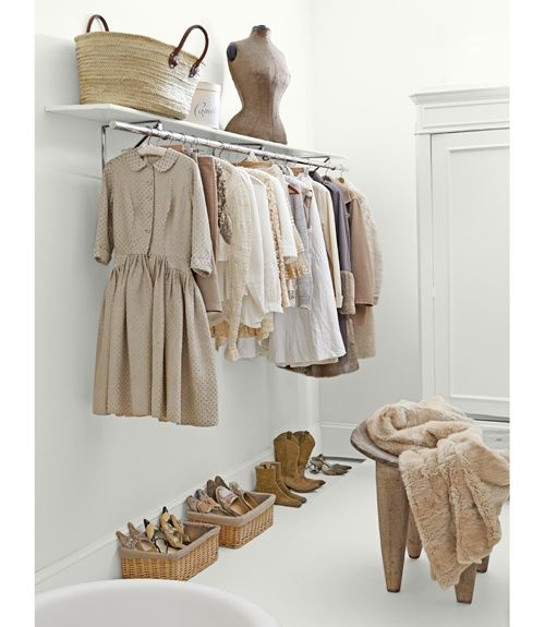 Can you imagine having a closet that looked like this??? I think a part of me would shrivel up in some way if I didn't have colour...