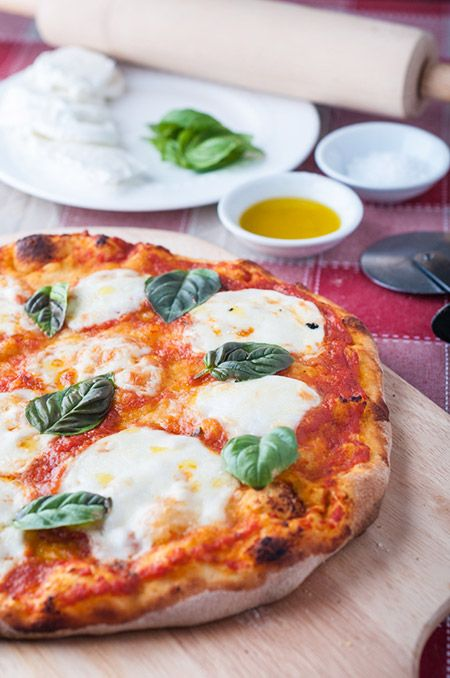 This stone baked Margherita pizza recipe is amazing! This pizza is made with homemade tomato sauce, buffalo mozzarella
