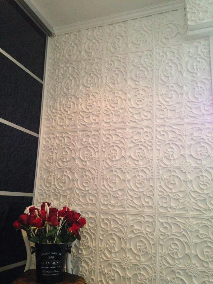 Spray painted rubber floor mats on wall!                                                                                                                                                                                 More