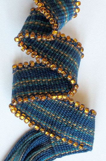 The article teaches beaded edge using beads on the warp threads on a rigid-heddle loom, but it would be much easier to add beads to an Inkle or card-woven band by threading your beads onto the WEFT thread instead!