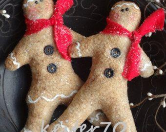 Rellenos del tazón de fuente de Navidad primitiva Gingerbread Boy y Girl Ornies