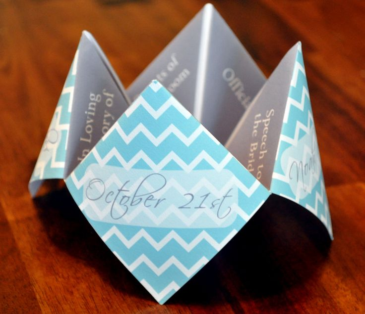 Aiming for a bit of an eldritch flavor at your commitment ceremony? Help your guests see the future with printable cootie catcher programs!