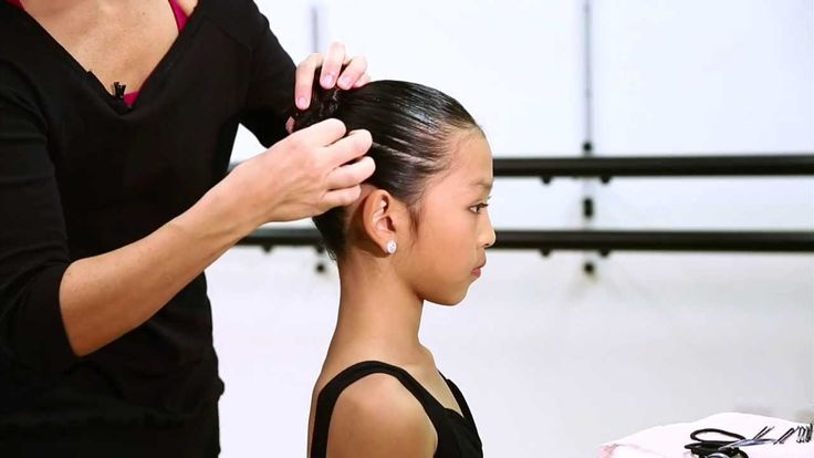 "A performance bun needs to be secure, sleek and clean. There should be no ""fly away"" or ""wispy"" hairs around the dancers face or from the bun."