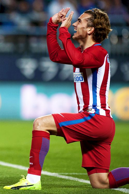 "liomessis:  ""Atletico Madrid's French forward Antoine Griezmann celebrates a goal during the Spanish league football match Malaga CF vs Club Atletico de Madrid at La Rosaleda stadium in Malaga on April 1, 2017.  """