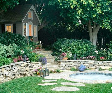 cute mini house, really a fancy garden shed, impeccable stone walls and little garden.
