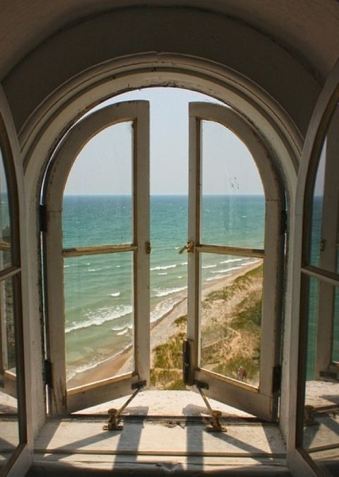 old window room with ocean view