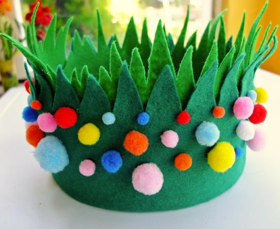 A crown for Easter made from felt and brightly coloured pom poms