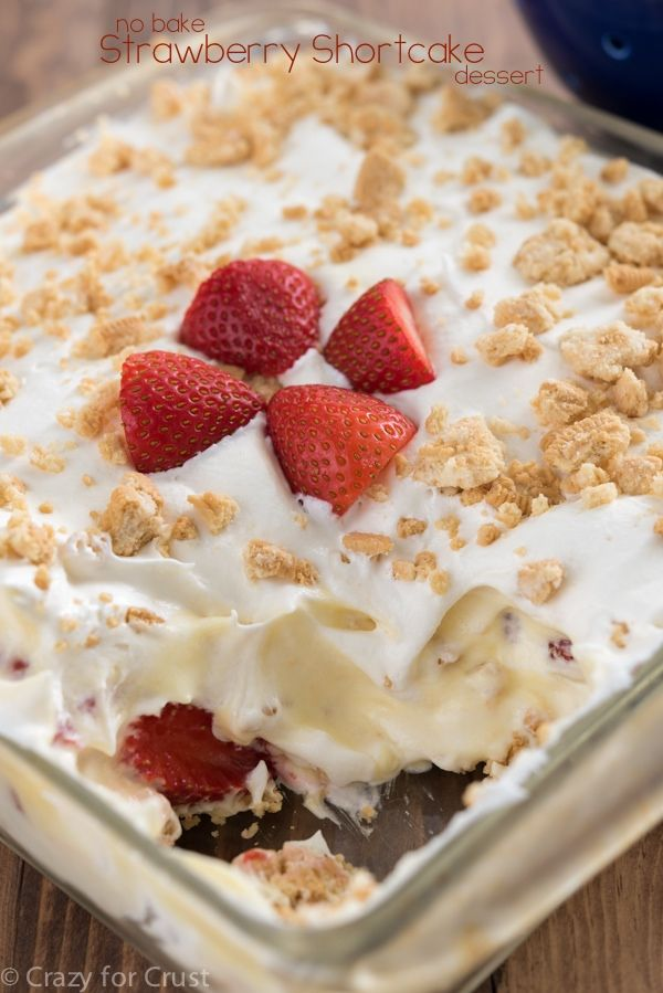 Easy No-Bake Strawberry Shortcake Dessert with layers of pudding and whipped cream, strawberries and crushed cookies. The perfect strawberry recipe for summer!