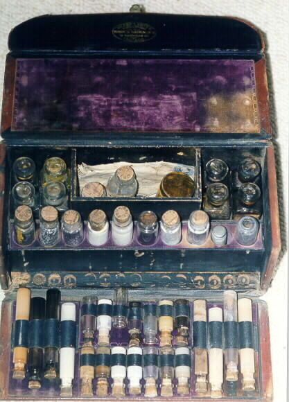 Post  1886 leather and wood medical kit with drugs by Sharp and Smith. Note cork caps on vials.  Has letter to original owner, Dr. Smith.