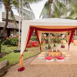 Marquee with draping  and floor seating - beach theme - beach party