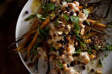 The roasted garlic dressing is as luscious as mayonnaise and gives this salad a buttery, nutty flavour. Serve it as a meat-free starter or alongside grilled lamb or chicken.
