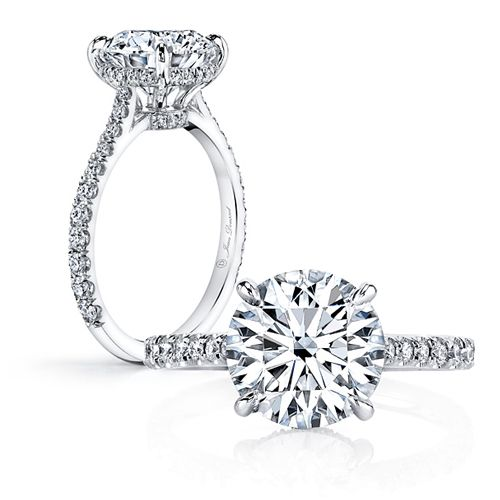 ANNA is a handcrafted Jean Dousset Diamonds solitaire engagement ring with one row of diamonds on the band and pictured with a Round Brilliant cut diamond in Platinum.