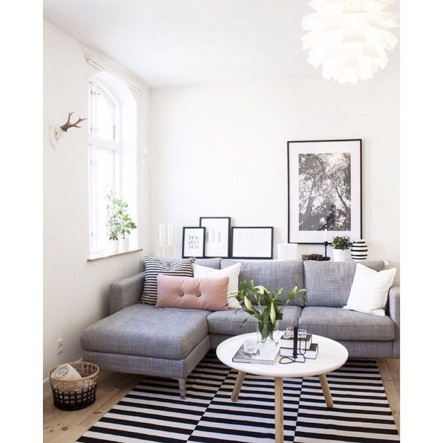 Living room of @hafdishilm - the sofa and rug are from Ikea, the coffee table is a Normann Copenhagen Tablo table and the blush dot cushion is by Hay