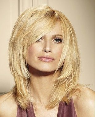 A long blonde straight coloured choppy hairstyle by Franck Provost...cut off at layer below chin
