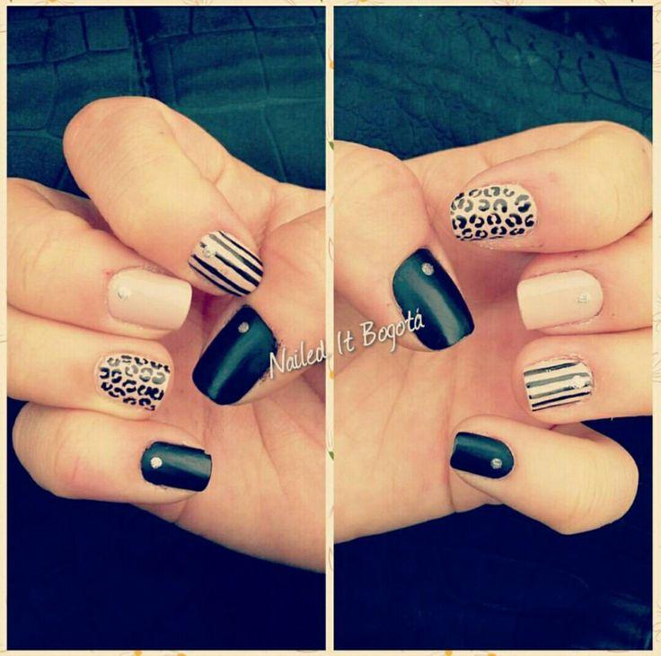 Matte black nail design, animal print, stripes and nude