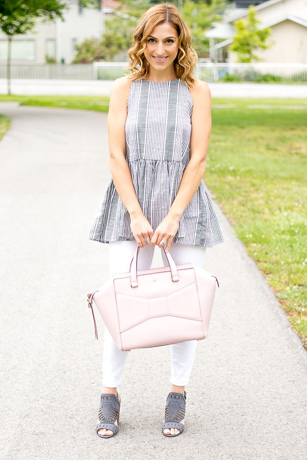Cute peplum top with black and white stripe. Peplum top with skinny white jeans and pink bag.