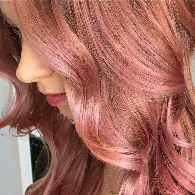 Close up of this gorgeous dimensional color created using Paul Mitchell Shines Xg over preligtened hair. I played with 7r7rv9v and clear in different ratios and dilutions, handpainting and colormelting the different formulas  for a soft organic blend