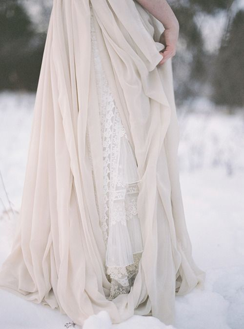 Her ivory skirts dragged through the sparkly snow of castle courtyard. Her coronation was in three short hours. In three short hours, she would be queen.
