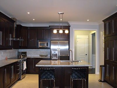 light floors, dark kitchen cabinets. gray walls, light counter tops  paint color is: ICI Dulux Silver Cloud. VOC-free Dulux Lifemaster line.  LOVE cabinetry color, paint color, light counters & crown molding
