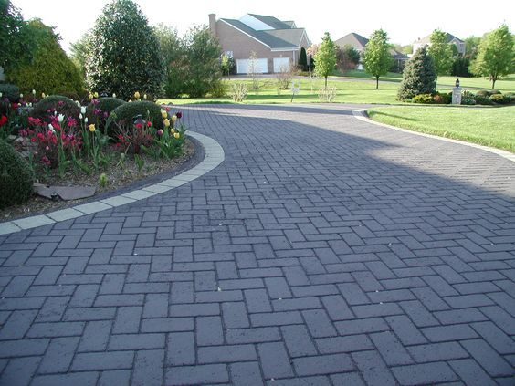 Beautiful landscaping and decorative stamped asphalt driveways go hand-in-hand