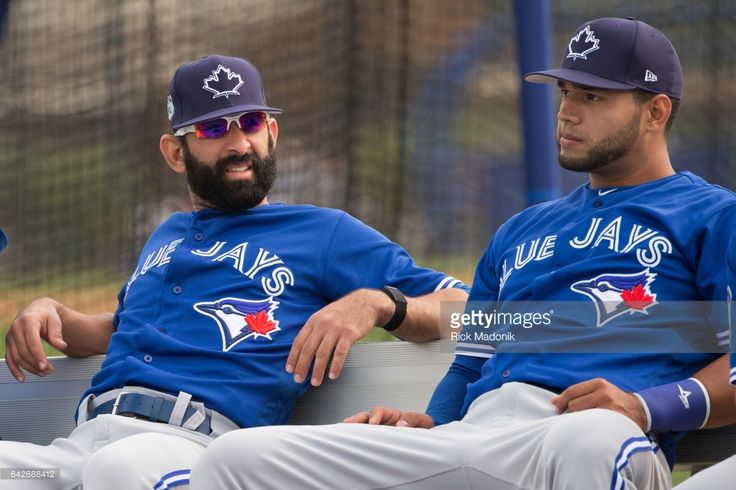 Jose Bautista (left) sits on the bench with Lourdes Gurriel before the start of warm up. Toronto Blue Jays welcome the entire squad today as position players join the pitchers and catchers in Dunedin. Today was the first full workout as they team prepares for the upcoming Grapefruit season at Bobby Mattick Training Centre. Toronto Star/Rick Madonik