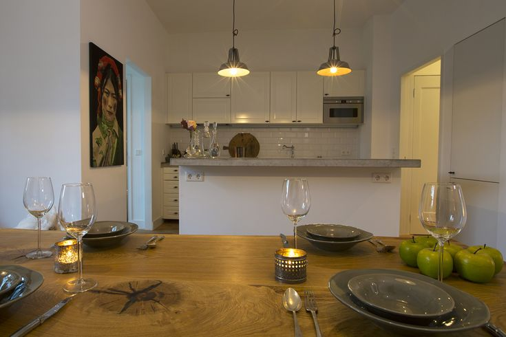 Ikea kitchen with concrete top and concrete lamps