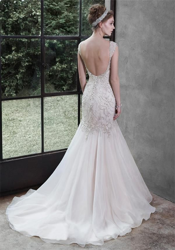 Stunningly Beaded Mermaid Trumpet Wedding Dress With Cap Sleeves And Low Back By Designer Maggie Sottero Available At The Bridal Cottage In NLR AR
