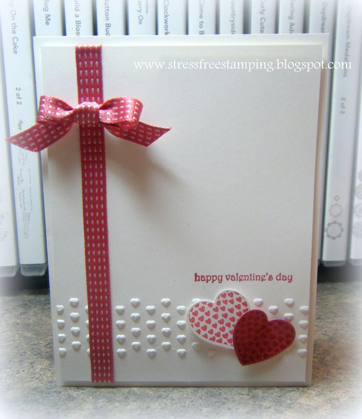 handmade Valentine card ... luv the clean look of this card ... perfect bow ... good balance in the design ...