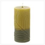 Luscious shades of tone-on-tone green perfectly complement the all-over leaf motif of this triple-wick candle. The perfect combination of color and texture!
